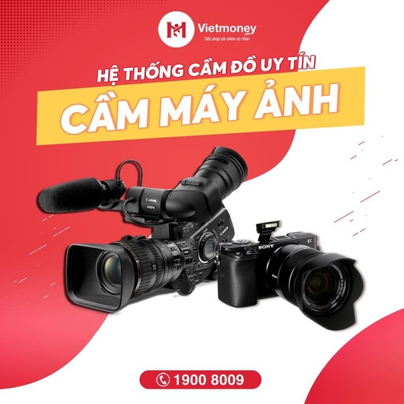 cầm máy ảnh